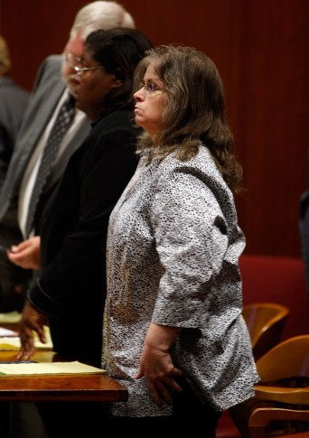 Denise Frei stands as the jury exits the court room for a motion