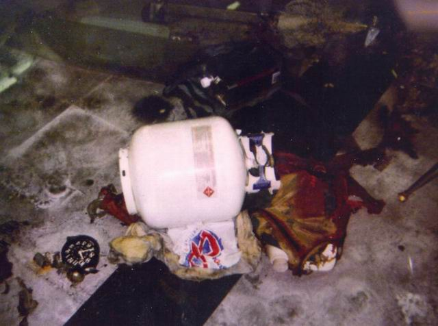 One of the two big propane bombs in the cafeteria  The timing device    Columbine Shooting Crime Scene Photos